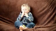 Boy eating corn flips video