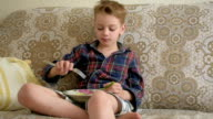 boy eating fresh cucumbers video