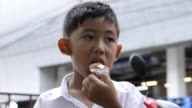 Boy eating fried chicken video
