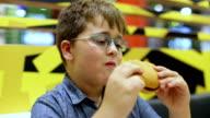 boy eating hamburger video