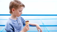 boy eating ice cream cone with chocolate video