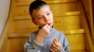 Boy eating orange video