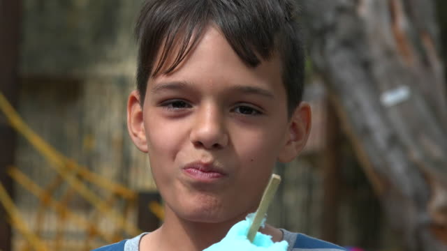 Boy Eating Sugary Snack video