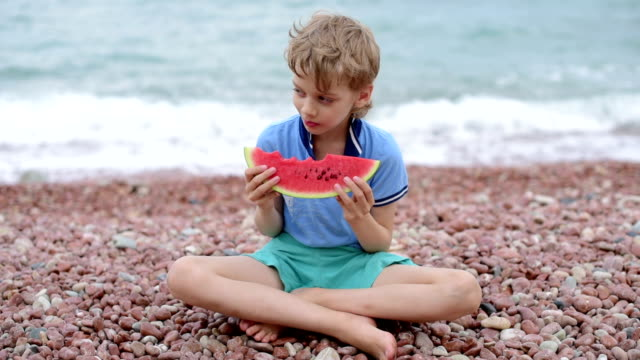 boy eating watermelon video
