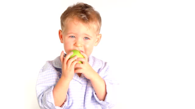 Boy eats apple video