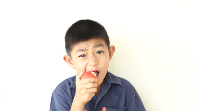 Boy eats apple video