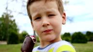 Boy enjoying delicious ice cream video