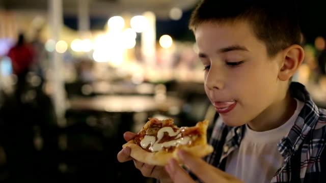 Boy enjoys in pizza video