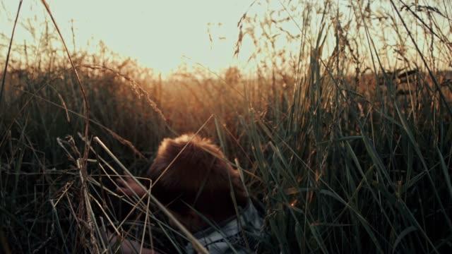 SLO MO Boy falls down on the green grass video