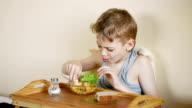 boy having breakfast, close up video