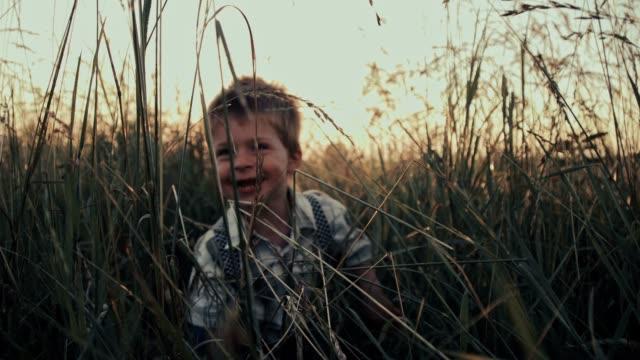 SLO MO Boy having fun laughing in grass video