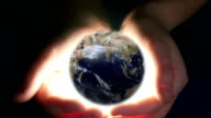 Boy Holding Earth In Her Hands video