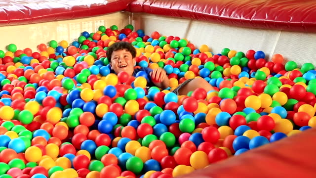 Boy  in a ball pool video