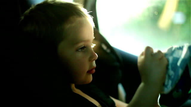 Boy in his child safety car seat video