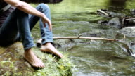 boy in river shore with barefoot - in contact with nature video