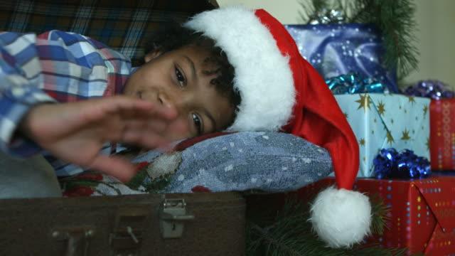 Boy in Santa hat smiling. video