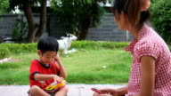 boy is calling to mother with toy telephone video