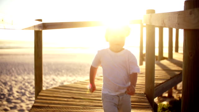 Boy is running down the jetty video