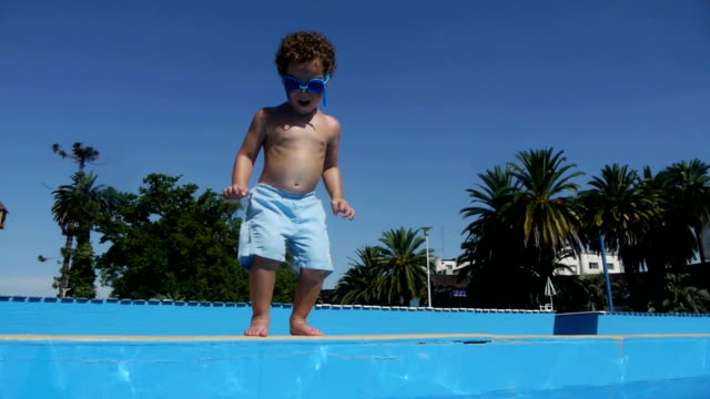 Boy jumping and diving Swimming Pool. Kids. Slow Motion video