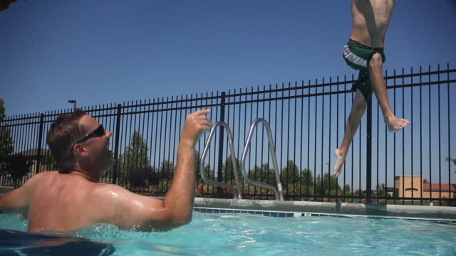 Boy jumps into pool and catches ball video
