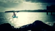 Boy Kayaking In The Ocean video