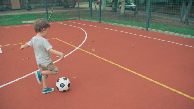 Boy kicking soccer ball video