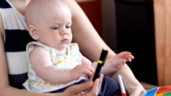 Boy learning handwriting practice from mother video