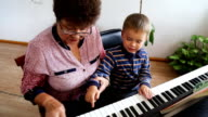 Boy learning how to the play piano video