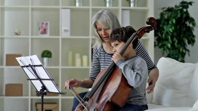 Boy Learning to playing Cello video