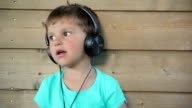 Boy listening to music on headphones video