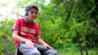 Boy listening to music video