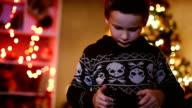 Boy Looking Photos on Christmas Eve video