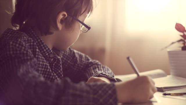 Boy making his homework video