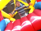 Boy on bouncy castle and cute smile video