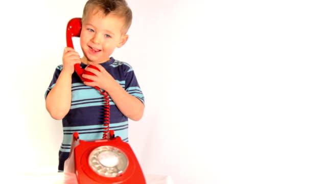 Boy on telephone video