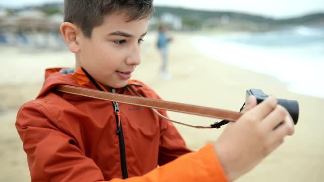 Boy photographer video