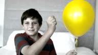 Boy piercing his balloon video