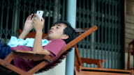 Boy play Smart Phone video