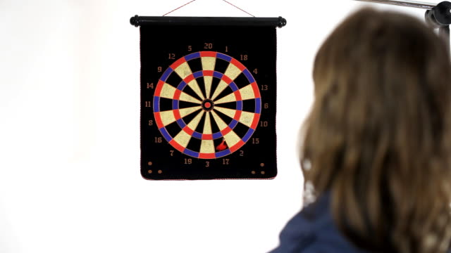Boy playing darts video