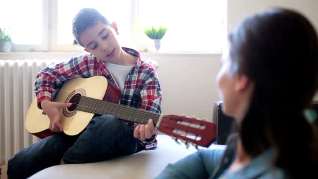 Boy playing guitar video