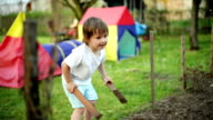 Boy playing in back yard video