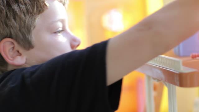 Boy Playing in Dollhouse video