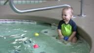 Boy playing in pool 2 HD video