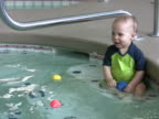 Boy playing in pool 2 NTSC video
