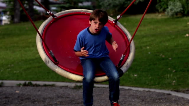 Boy Playing on Swing video