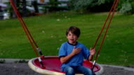 Boy Playing on Swing video