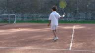 Boy playing tennis video