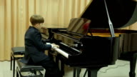 Boy playing the grand piano video