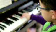boy playing the piano video