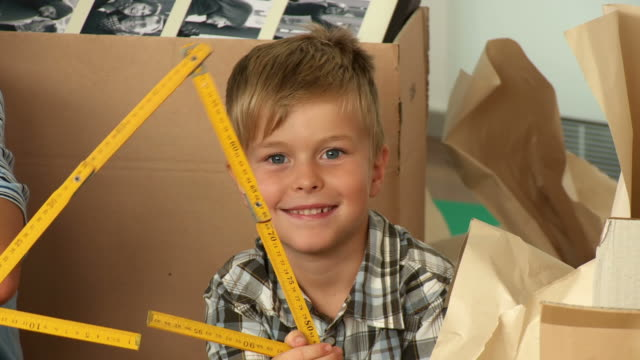 HD: Boy Playing With Folding Ruler video